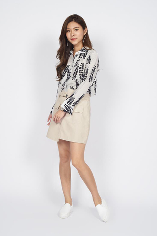 Belted Faux Leather Mini Skirt in Beige